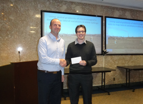 David Allan of Fugro presents the Fugro scholarship to Michal Kolaj.