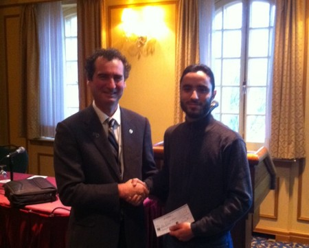 Jean Legault, KEGS, presents GSC Pioneers Scholarship to Majid El Baroudi at Nov 23 KEGS/Québec breakfast.