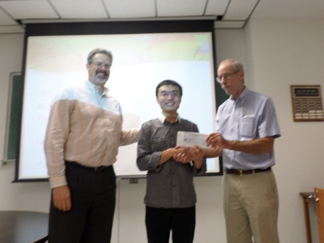Scholarship presentation to Kun Guo by Stephen Reford and Jerry Roth.