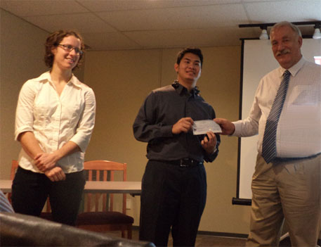 UBC scholarship recipients Tess Baker and Hakim Shukri with Peter Kowlaczyk, Dir.