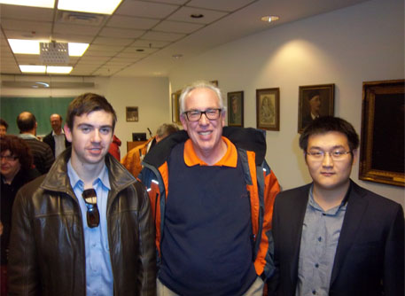 Professor Tony Endres with scholarship recipients Phillip Van-Lane and Dong Shi.