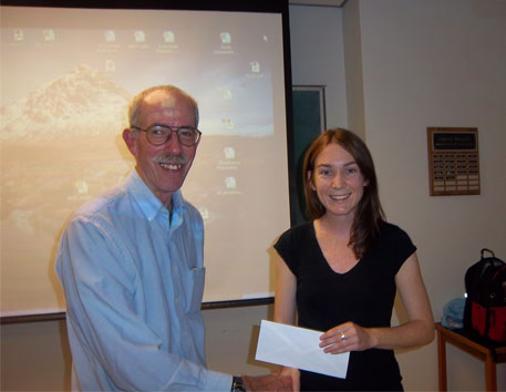 Jerry Roth presents scholarship to Laura Quigley at KEGS meeting.