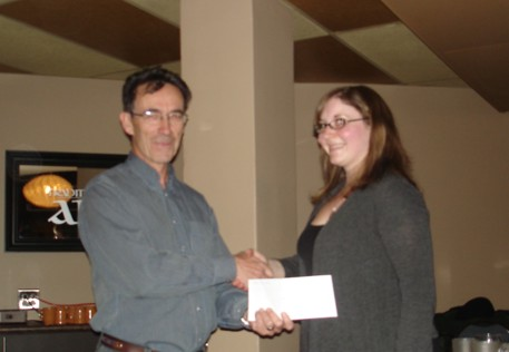 Christine Shiels (University of Saskatchewan) receiving her scholarship cheque from Prof. Jim Merriam.