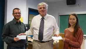 Scholarship presentation by Dennis Wood, Dir., to UVic students Erica Owen and Cedar Haneson at KEGS SL.